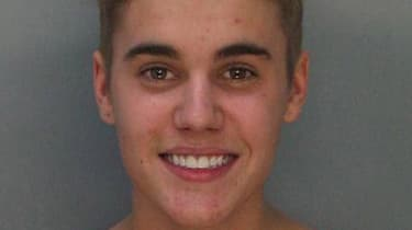 MIAMI, FL - JANUARY 23: In this handout photo provided by Miami-Dade Police Department, pop star Justin Bieber poses for a booking photo at the Miami-Dade Police Department on January 23, 201