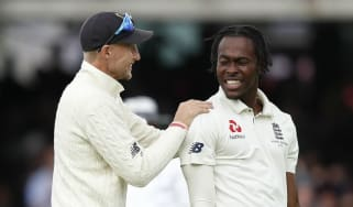 England captain Joe Root celebrates an Australia wicket with bowler Jofra Archer