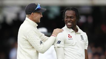 England captain Joe Root celebrates an Australia wicket with bowler Jofra Archer