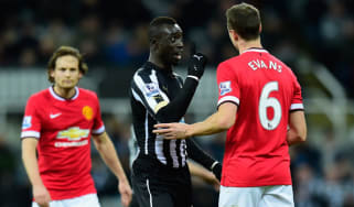 Manchester United player Jonny Evans amd Papiss Cisse of Newcastle United