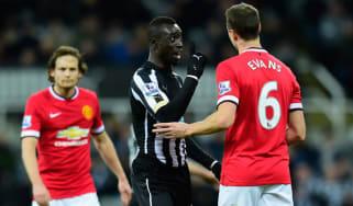 Manchester United player Jonny Evans amd Papiss Cisse of Newcastle United