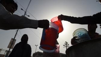 Residents in Karachi receive water in heatwave