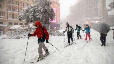 Skiiers in Madrid street