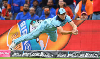 Chris Woakes takes a diving catch to dismiss Rishabh Pant during England's victory at the Cricket World Cup