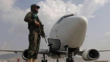 A Taliban fighter stands guard at Hamid Karzai International Airport in Kabul