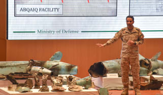 TOPSHOT - Saudi defence ministry spokesman Colonel Turki bin Saleh al-Malki displays pieces of what he said were Iranian cruise missiles and drones recovered from the attack site that targete