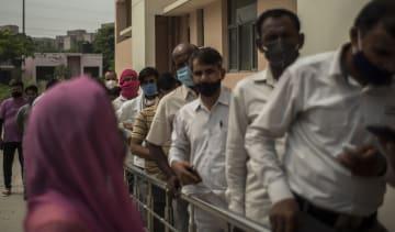 Patients queue for a vaccination in Noida, India