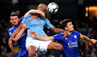 Leicester defenders Ben Chilwell and Harry Maguire battle with Man City's Vincent Kompany