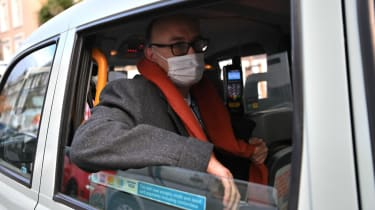 Dominic Cummings in a London black cab wearing a face mask.