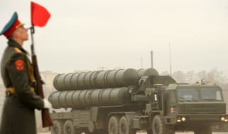A Russian solider near a truck with missiles