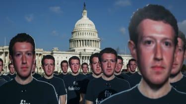 Protesters don Mark Zuckerberg mask before his Senate hearing