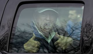 Donald Trump gives a thumbs up to supporters after golfing at Trump National Golf Club