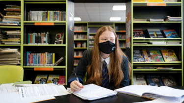 Girl at school wearing a facemask