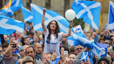 GLASGOW, SCOTLAND - SEPTEMBER 17:A young women joins Yes activists as they gather in George Square on September 17, 2014 in Glasgow,Scotland.The referendum debate has entered its final day of