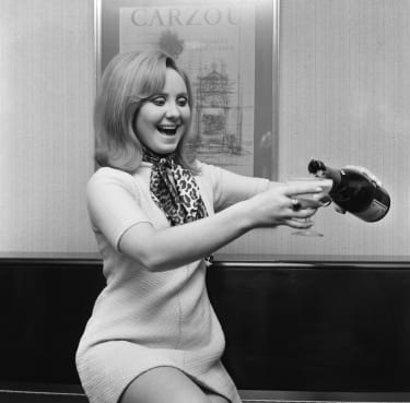 Lulu, pictured at her London flat celebrating after she has learnt that her single To Sir With Love has gone to number one in all the American pop charts, and is on the way for a golden disc