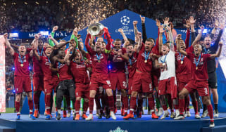 Liverpool captain Jordan Henderson lifts the Champions League trophy in Madrid