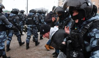 Riot police detain a man during a rally in support of jailed opposition leader Alexei Navalny