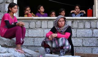 Yazidi women take shelter at a school in the Kurdish city of Dohuk