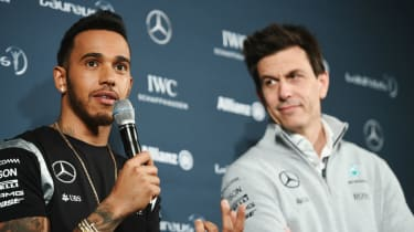 Formula 1 world champion Lewis Hamilton and Mercedes team boss Toto Wolff