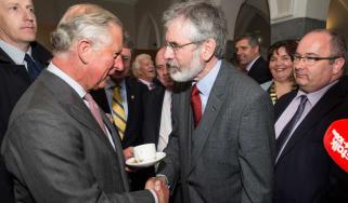 Prince Charles shakes Gerry Adams' hand