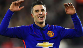 Robin van Persie of Man United celebrates scoring his second goal during the match between Southampton and Manchester United