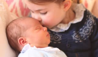 Princess Charlotte kisses her brother Prince Louis