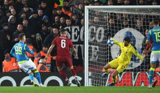 Liverpool's Brazilian goalkeeper Alisson saves the shot from Napoli striker Arkadiusz Milik