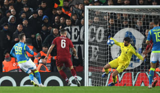 Liverpool's Brazilian goalkeeper Alisson saves the shot from Napoli striker Arkadiusz Milik