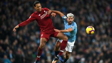 Liverpool defender Virgil van Dijk in action against Manchester City striker Sergio Aguero