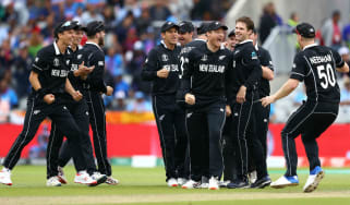 New Zealand players celebrate Martin Guptill's superb run out of India's MS Dhoni