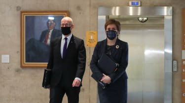 Deputy First Minister John Swinney arrives in Holyrood with Nicola Sturgeon