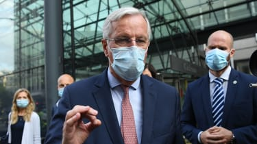 Michel Barnier address the press outside the European Commission building in Brussels
