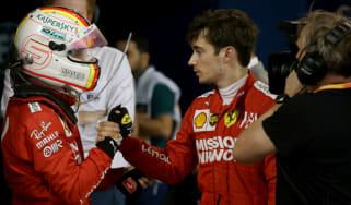 Sebastian Vettel consoles his Ferrari team-mate Charles Leclerc at the F1 Bahrain Grand Prix