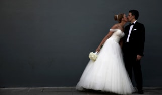 Newlyweds pose for a picture after their wedding ceremony