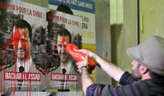Syrian activists splash paint on President Assad's election posters