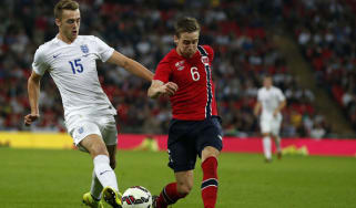 England's Calum Chambers and Norway's Stefan Johansen