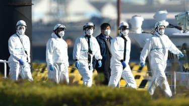 Officials at the Japan Coast Guard base in Yokohama where a cruise ship is in quarantine following an outbreak of coronavirus