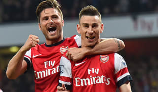 Arsenal players Laurent Koscielny with Olivier Giroud
