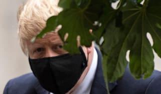 Boris Johnson wearing a face mask.