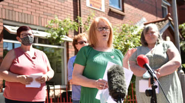 Families of victims of the 1971 Ballymurphy Massacre address reporters following Brandon Lewis' announcement