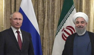 Russian President Vladimir Putin with Iranian President Hassan Rouhani in Tehran last year