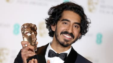 LONDON, ENGLAND - FEBRUARY 12:Supporting Actor winner Dev Patel poses with his award in the winners room during the 70th EE British Academy Film Awards (BAFTA) at Royal Albert Hall on Februar