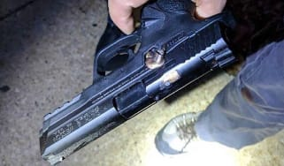 A bullet lodged in the side of a police officer's gun following a shooting in Chicago