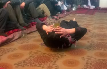 This photograph taken on February 18, 2017 shows an Afghan youth dancing at a private party in an unidentified location in Afghanistan.Bacha bazi is not seen as homosexuality in Afghanistan's