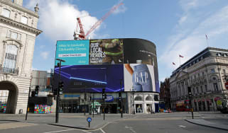 The electronic billboard displays an advert thanking Britain's emergency services for their dedication during the COVID-19 pandemic, in an empty in Piccadilly Circu in London on April 2, 2020