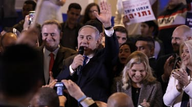 Israeli Prime Minister Benjamin Netanyahu waves to supporters during a Likud party campaign rally in Jerusalem on February 26, 2020. To his right stands his wife Sarah. - Next week's election