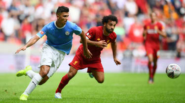 Manchester City midfielder Rodri in action against Liverpool's Mohamed Salah during the FA Community Shield in August