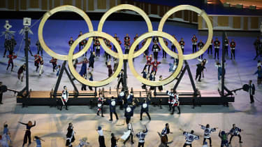Performers assemble the Olympic Rings during the opening ceremony