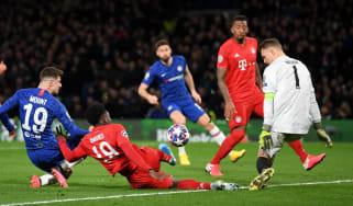 Bayern Munich goalkeeper Manuel Neuer saves a shot from Chelsea's Mason Mount