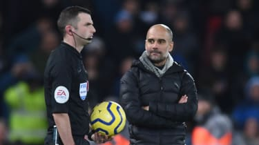 Man City boss Pep Guardiola confronted referee Michael Oliver after defeat at Liverpool